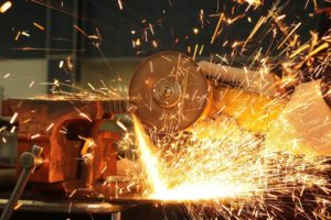 A metal cutting through a powerful machine