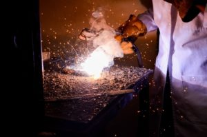 A person using a welding machine