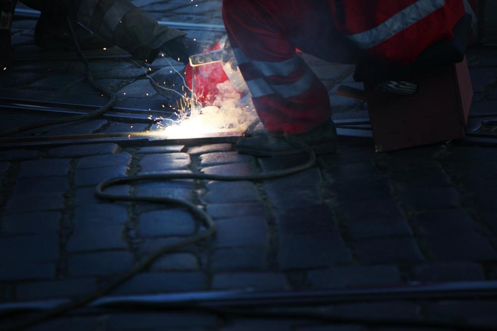 A worker welding a metal sheet.